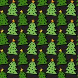 Christmas trees seamless pattern. Bright vector wrapping texture. Bright background for holiday decoration. Royalty Free Stock Photo