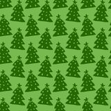 Christmas trees seamless pattern. Green vector wrapping texture. Background for holiday decoration. Royalty Free Stock Image
