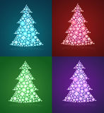 Christmas trees & a set of twinkling holiday decor Royalty Free Stock Photo