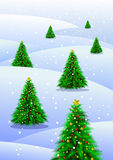 Christmas trees in snow. Illustration of decorated Christmas trees in snowing countryside Stock Photo