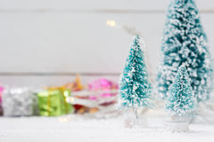Christmas trees with snow and gift boxes - selective focus Stock Image