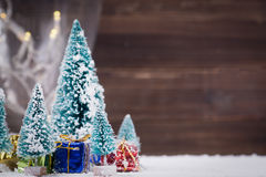 Christmas trees with snow and gift boxes - selective focus Royalty Free Stock Photos