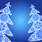Christmas trees from snowflakes. Blue christmas background. Royalty Free Stock Photo