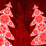 Christmas trees from snowflakes. Red christmas background. Royalty Free Stock Photos