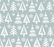 Christmas trees and snowflakes, seamless grey background. Royalty Free Stock Image