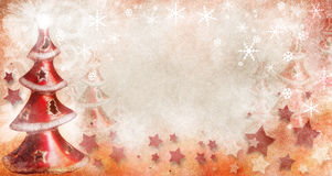 Christmas trees with snowflakes. A textured group of red Christmas trees with snowflakes and stars Royalty Free Stock Photo
