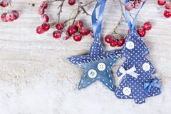Christmas trees and stars on a branch with berries Royalty Free Stock Photography