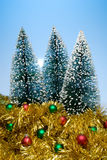Christmas trees and tinsel Royalty Free Stock Images