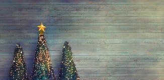 Christmas trees on wood stock image