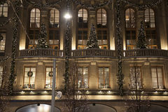 Christmas trees, wreaths and decorations. Christmas trees, wreaths, decorations and lights on a well-lit historic building in Stockholm, Sweden Stock Photo