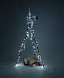 Christmas tripod. Christmas camera tripod with lights and gifts Stock Photos