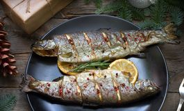 Christmas trout baked fish on table with ornament stock photo