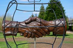 Christmas Truce memorial at the National Memorial Arboretum, Alrewas. Christmas Truce Memorial showing soldiers handshake within a globe, National Memorial stock photography