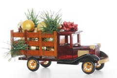 Christmas Truck. A vintage, wooden, model pickup truck hauling  holiday decorations Royalty Free Stock Photos
