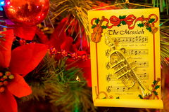 Christmas Trumpet. Christmas tree with trumpet and music ornaments royalty free stock image