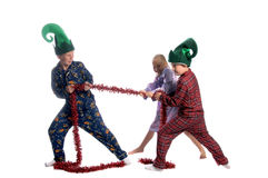 Christmas Tug o War Royalty Free Stock Image