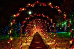 Christmas tunnel arches and festive lighting stock image