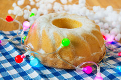 Christmas turban cake with lights Royalty Free Stock Photos