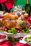 Christmas turkey on holiday table Stock Photography