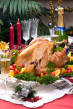 Christmas turkey on holiday table Royalty Free Stock Images