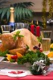 Christmas turkey on holiday table Stock Photos