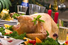 Christmas turkey on holiday table Stock Image