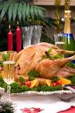 Christmas turkey on holiday table Stock Image