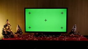 Christmas TV with green screen composited. TV or television - green screen - room - on the table. Christmas time