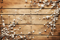 Christmas twigs of spruce arranged on aged wooden planks backgro Stock Images