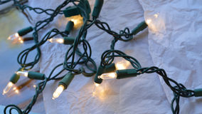 Christmas twinkle lights. Against white background royalty free stock image