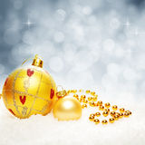 Christmas Twinkled Bokeh Background with Xmas Balls and Snow Royalty Free Stock Photos