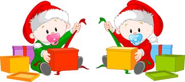 Christmas  twins  open gift Royalty Free Stock Photos