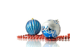 Christmas two blue balls and red beads Stock Images