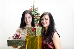 Christmas: Two girls with gifts Royalty Free Stock Photos