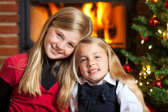 Christmas two girls smiling stock photography