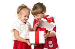 Christmas. Two little girls open white box Stock Images