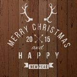 Christmas type design. Over wooden background Royalty Free Stock Photo