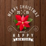 Christmas type design. Over wooden background Stock Image