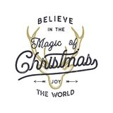 Christmas typography quote design. Believe in Christmas magic. Happy Holidays sign. Inspirational print for t shirts. Mugs, holiday decorations, signage. Stock Stock Photo