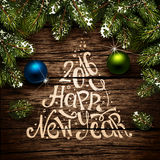 Christmas typography on wooden texture Royalty Free Stock Images