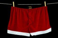Christmas Underwear on Washing Line on Black Background Stock Photo