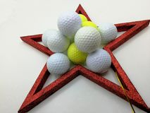 Christmas card inspired by golf framed by a red star Royalty Free Stock Photos
