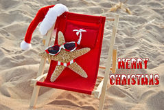 Christmas starfish in red beach chair Stock Photography