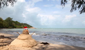 Christmas vacation. Snowman on a tropical beach Stock Images