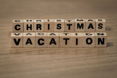 Christmas vacation in wooden cubes Stock Images