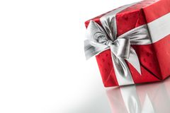 Christmas valentine or birthday red gift box with silver ribbon. Isolated on white Stock Photos