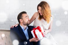 Christmas concept - pretty girl giving gift box to her boyfriend Royalty Free Stock Photography