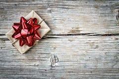 Christmas, Valentine`s Day, date, birthday, love, Gift box, red. Christmas, Valentine`s Day, date, birthday, love. Gift box with a red bow on a wooden background Stock Photo
