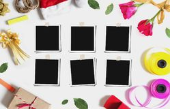 Christmas, Valentines gifts preparation with blank photo frames, on white table royalty free stock photos