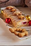 Christmas vanilla roll cake and cookies royalty free stock photos